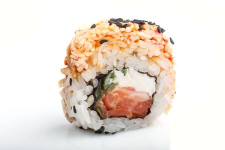 Japanese maki sushi rolls with salmon, sesame, isolated on white background. Side view, close up, selective focus. 写真素材