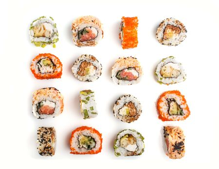 Set of Japanese maki sushi rolls in a rows with salmon, sesame, avocado, cheese and cucumber isolated on white background. Top view, flat lay, close up. 写真素材