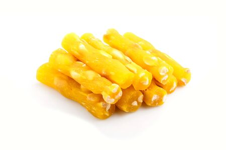 yellow traditional turkish delight (rahat lokum) with peanuts isolated on white background. side view, close up.
