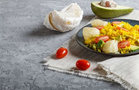 Fried pomelo with tomatoes and avocado on gray concrete background. side view, close up, copy space, myanmar food. Stock fotó