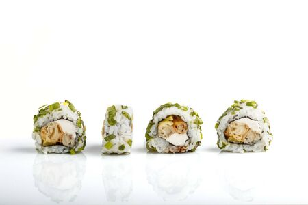 Four Japanese maki sushi rolls in a row with cream cheese and onion isolated on white background.Side view, close up.