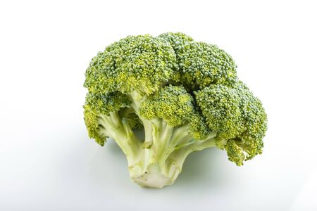 Fresh green broccoli isolated on white background, side view, close up.