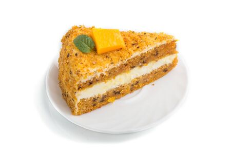 Homemade cake with persimmon and pumpkin isolated on white background. side view, close up.