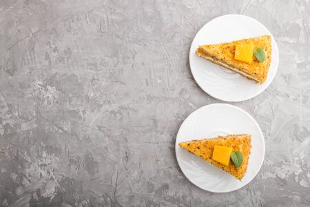 Homemade cake with persimmon and pumpkin on a gray concrete background. top view, flat lay, copy space.