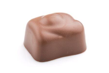 Single chocolate candy isolated on white Reklamní fotografie