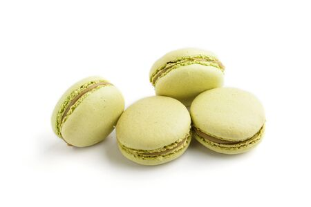 Green macarons or macaroons cakes isolated on white background. side view, close up, macro.