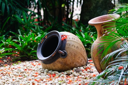 Two classic urns in the stone park.