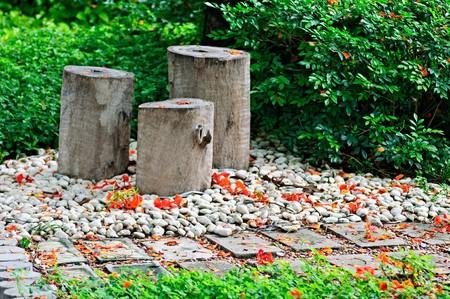 Three wooden stool in relaxation styles garden. Stock Photo