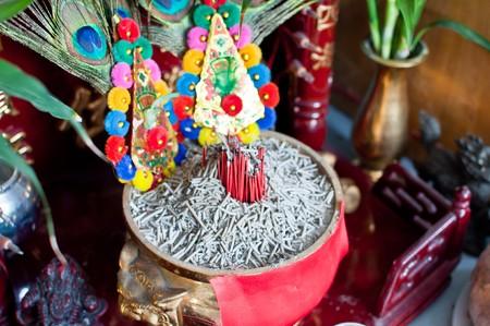 Burning incense in the censer.