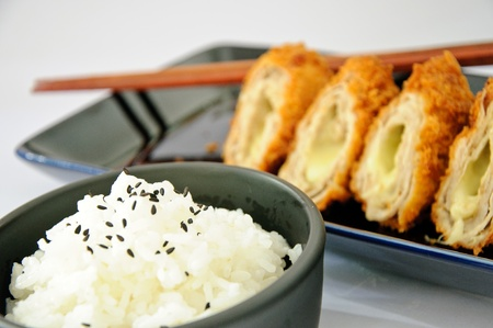 Japanese deep fried roll pork with cheese. Serve with Japanese rice.