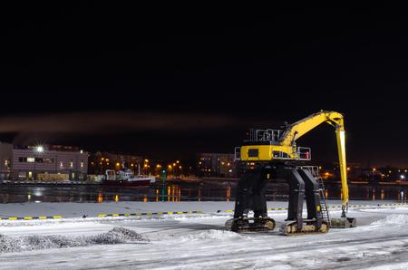Hydraulic manipulator waiting for work - port of Ventspils, Latvia Stock Photo