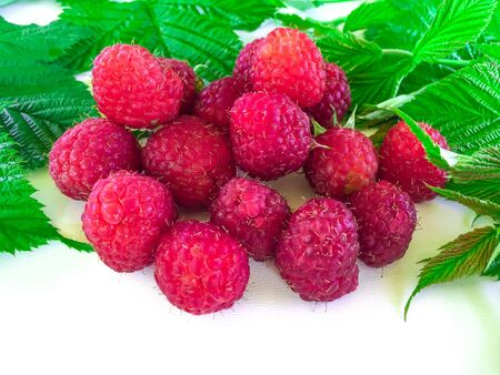 Fresh berries of a raspberry with leaves Reklamní fotografie