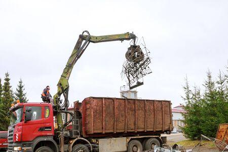 Skutec, Czech Republic, 21 November 2019: A grapple truck loads scrap industrial metal for recycling Editorial