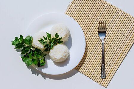 boiled rice on white plate on white background Zdjęcie Seryjne