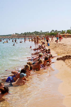 Hurghada, Egypt, 16 october 2018: A group of people doing water aerobics on the beach of the Red Sea. Editoriali