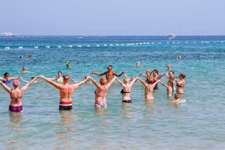 Hurghada, Egypt, 16 october 2018: A group of people doing water aerobics on the beach of the Red Sea.