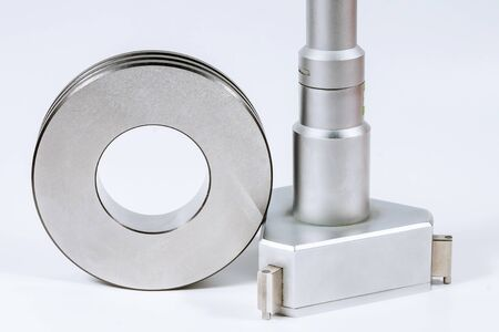 Calibration Micrometer. Device for accurately measuring the diameter of the hole, on a white background