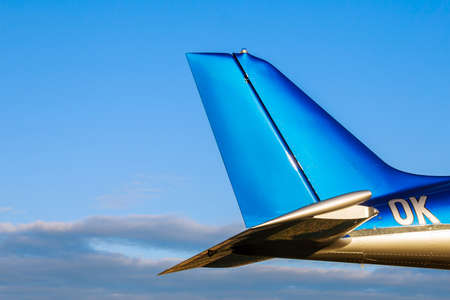 Tail of a small 2-seater aircraft on background of a blue sky. Close up.