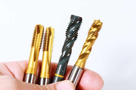 Tap for threading in metal. Tap and die nuts for metal processing