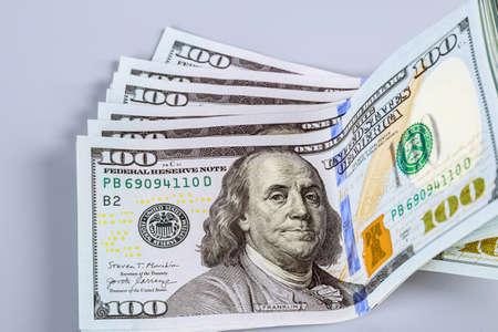 American dollars on a gray background. Counts one hundred dollar bills. Zdjęcie Seryjne