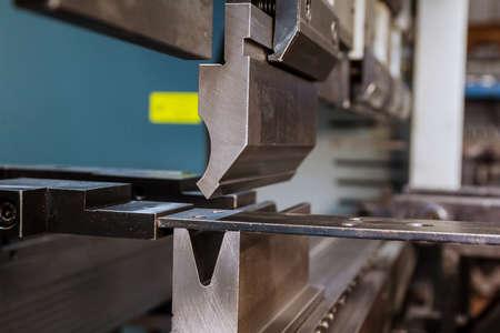 Modern hydraulic metal bending machine in a metallurgical factory