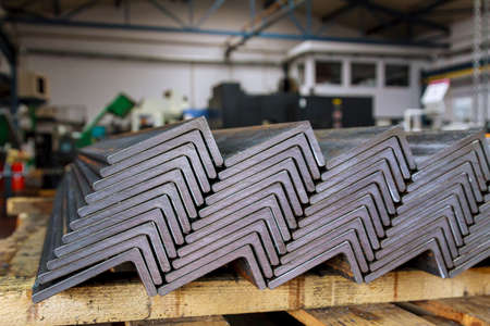 Rolled metal. Stack of angle steel in the factory. L-profil.