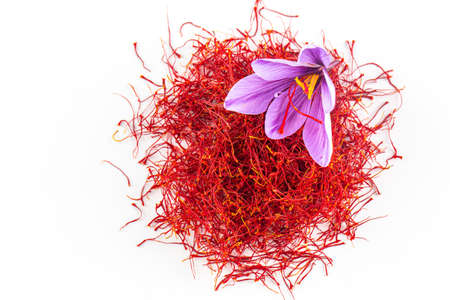 Fresh saffron flower on a background of dried saffron on a table. Place for your text Banque d'images