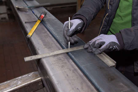 Marking tools. markings on a metal surface for drilling holes.