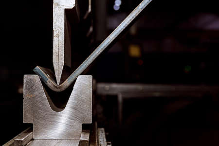 Working with sheet metal and special bending machines. hydraulic press brake or bending machine for sheet metal.