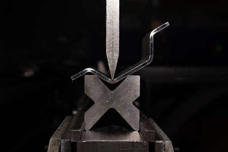 working with sheet metal on CNC hydraulic press brake. Bending sheet metal