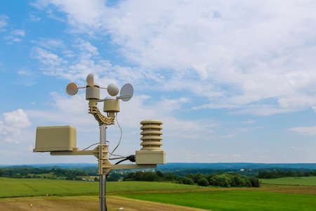 anemometer, wind speed measurement, small weather station. Anemometer on blue sky.