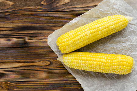 grilled corncob on wooden background