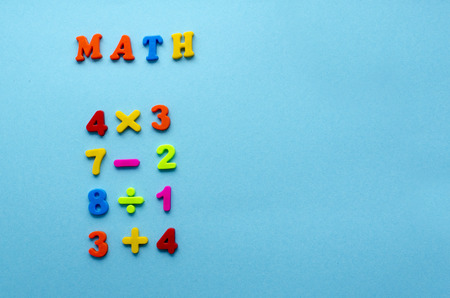 mathematical actions on blue paper background Stok Fotoğraf