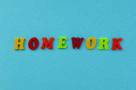 colorful word homework  of magnetic letters on blue paper background