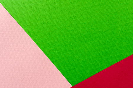 Colored geometric pink and green paper texture background.   Stock Photo