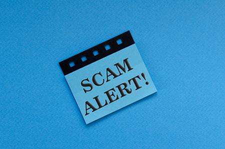 scam alert on sticker Stock Photo