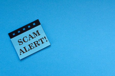 scam alert on sticker Imagens