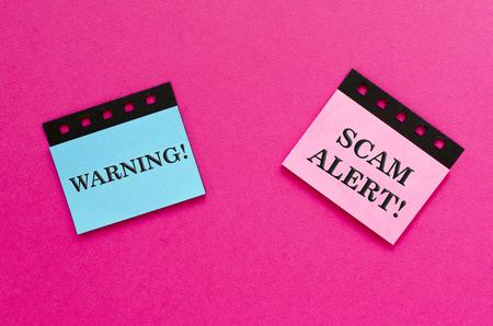 scam alert on sticker Stock Photo - 116275390