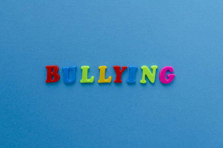 word bullying on blue background