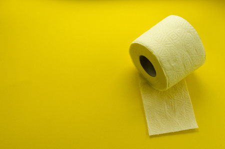 yellow toilet paper roll on yellow backgroung
