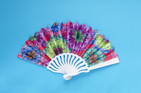 colored fan on paper background