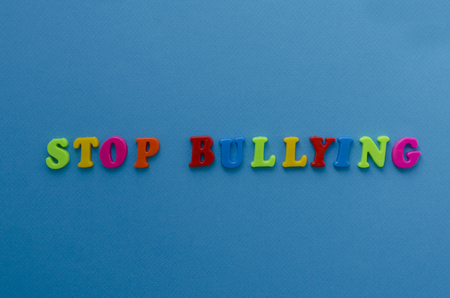 phrase stop bullying on blue background