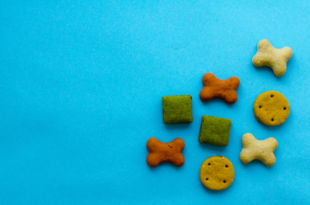biscuits for dogs on blue paper background