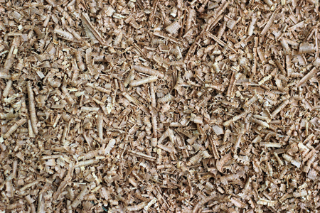 mulch: Wood chip shaving or shredded mulch material texture background Stock Photo