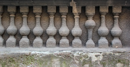 bannister: Bas relief of stone balustrade with one banister inverted.