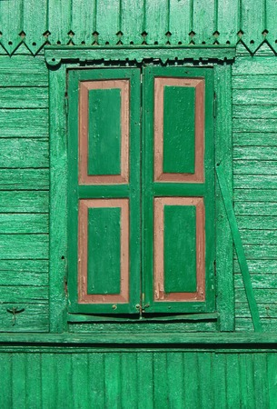 Old Painted Green Wooden Shuttered Window On Decorated Wall. Stock ...