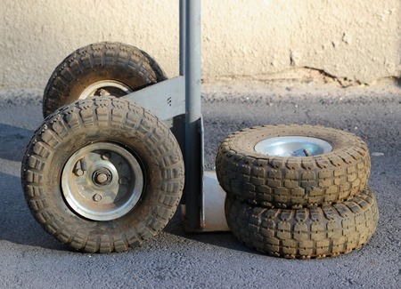 dolly bag: Wheels and flat tires of old broken hand truck