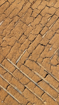 earthen: Old earthen adobe wall, background texture background Stock Photo