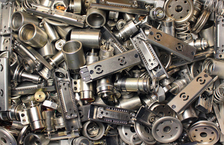 metal parts: Scattered parts of old disassembled hard drives Stock Photo