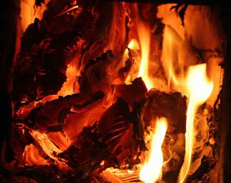 smolder: Burning paper and cardboard - orange glowing flames